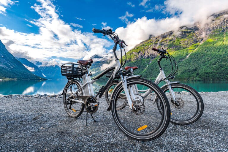 Two e-bikes parked on the beach