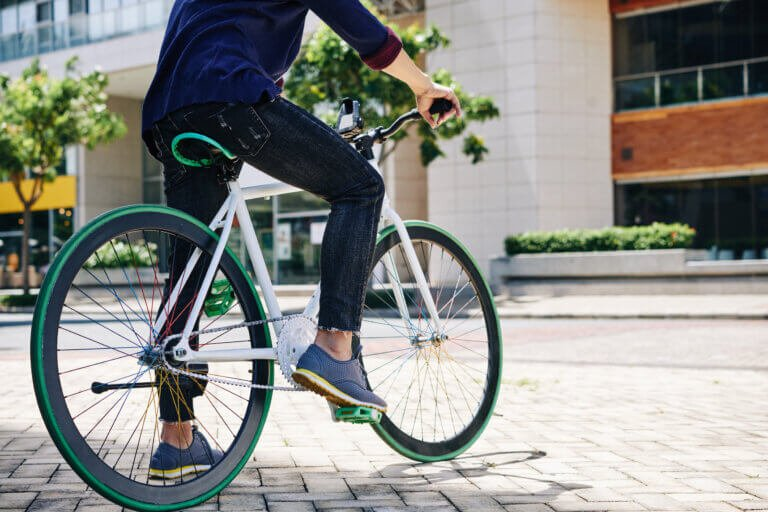 Cropped image of man sitting on bicycle and ready to ride