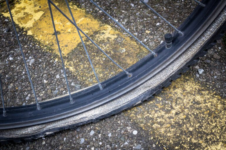 Flat bicycle tire, deflated.